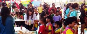 CEA Project Logistics staff giving free ice cream to school children