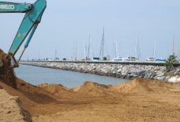 CEA Project Logistics - Heliotrope 65 Catamaran Transport and Launch - digging out the beach