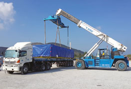 Cargo being loaded onto flatbed trailer at CEA Project Logistics Cargo Consolidation facility