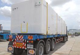 Shrinkwrapped cargo on flatbed trailer