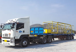 Break bulk cargo on flatbed trailer ready to leave for port