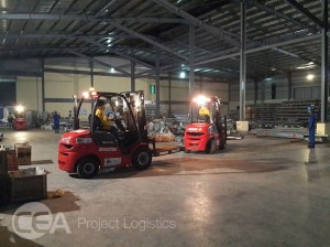 two cea forklifts inside thilawa warehouse