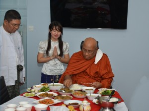 Monks eating meal in office