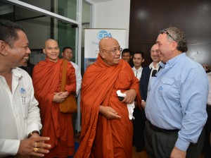 Kevin Fisher greets the monks