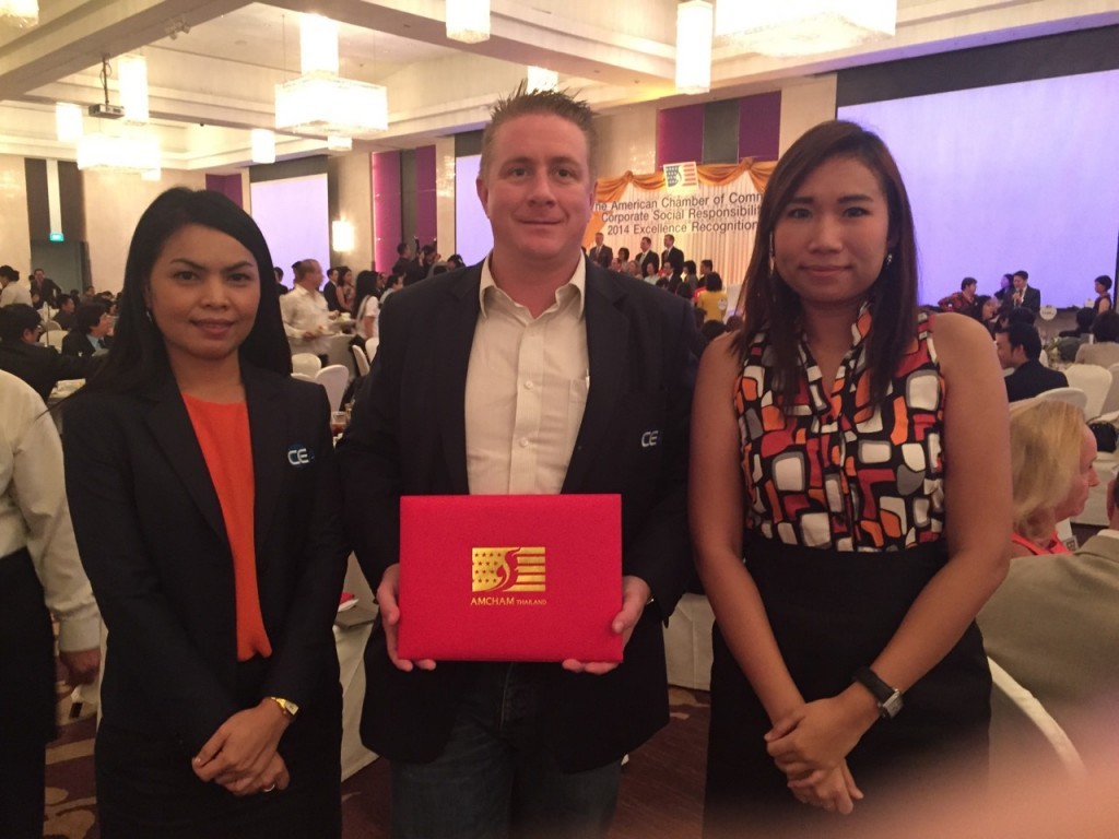 CEA Project Logistics Staff stand for photo with CSR award