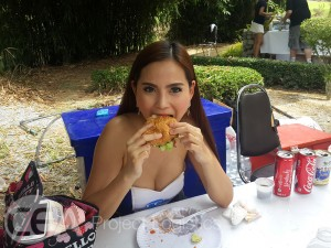 One of the CEA Project Logistics Team eating burgers