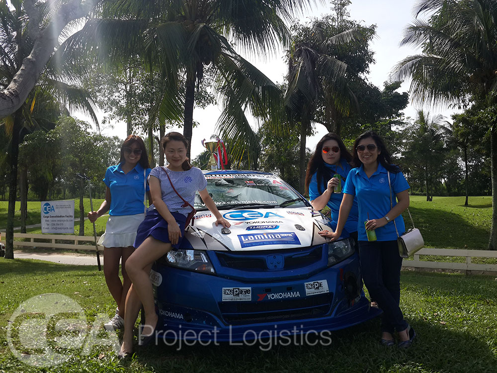 Female Golfers pose with the CEA Race Car