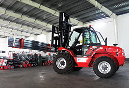 Forklift working inside warehouse