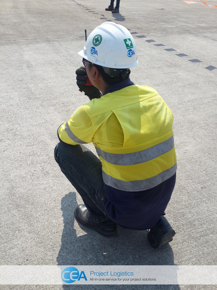 CEA Project Logistics marshall talking on walkie talkie
