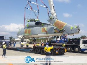 Helicopter being lowered on to trailer
