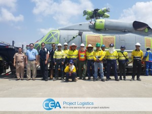 CEA Team pose for photo in front of seahawk helicopter
