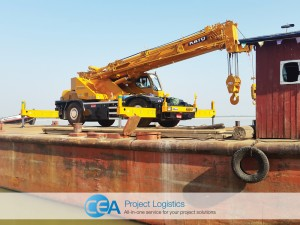 70 tonne yellow crane arrives on a river barge CEA Myanmar