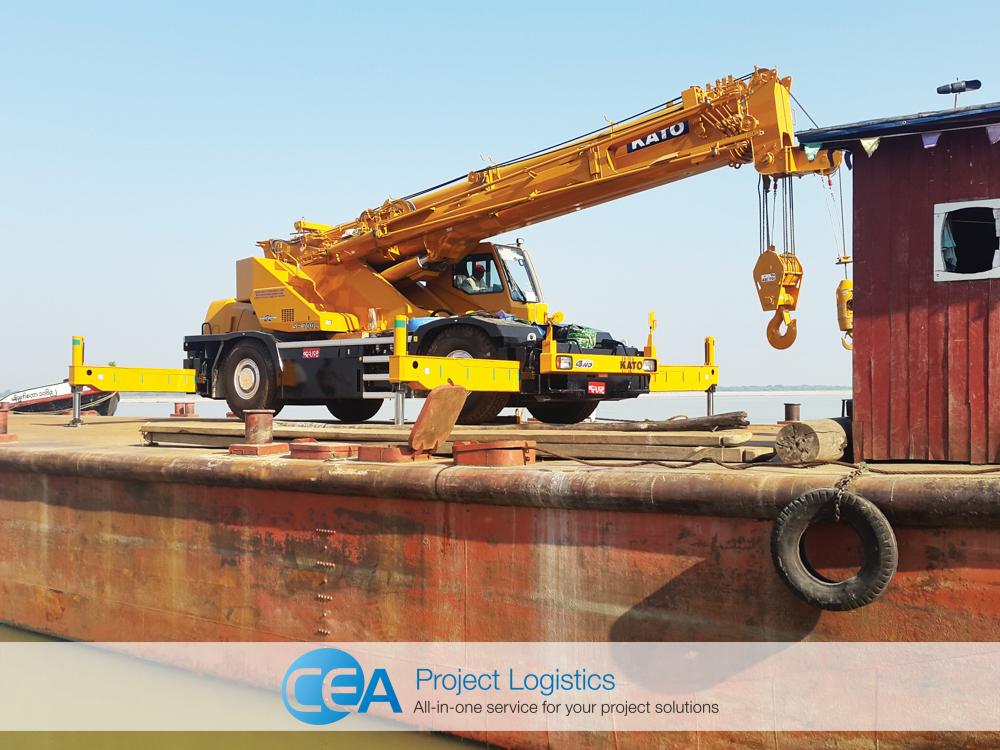 70 tonne yellow crane arrives on a river barge CEA Myanmar