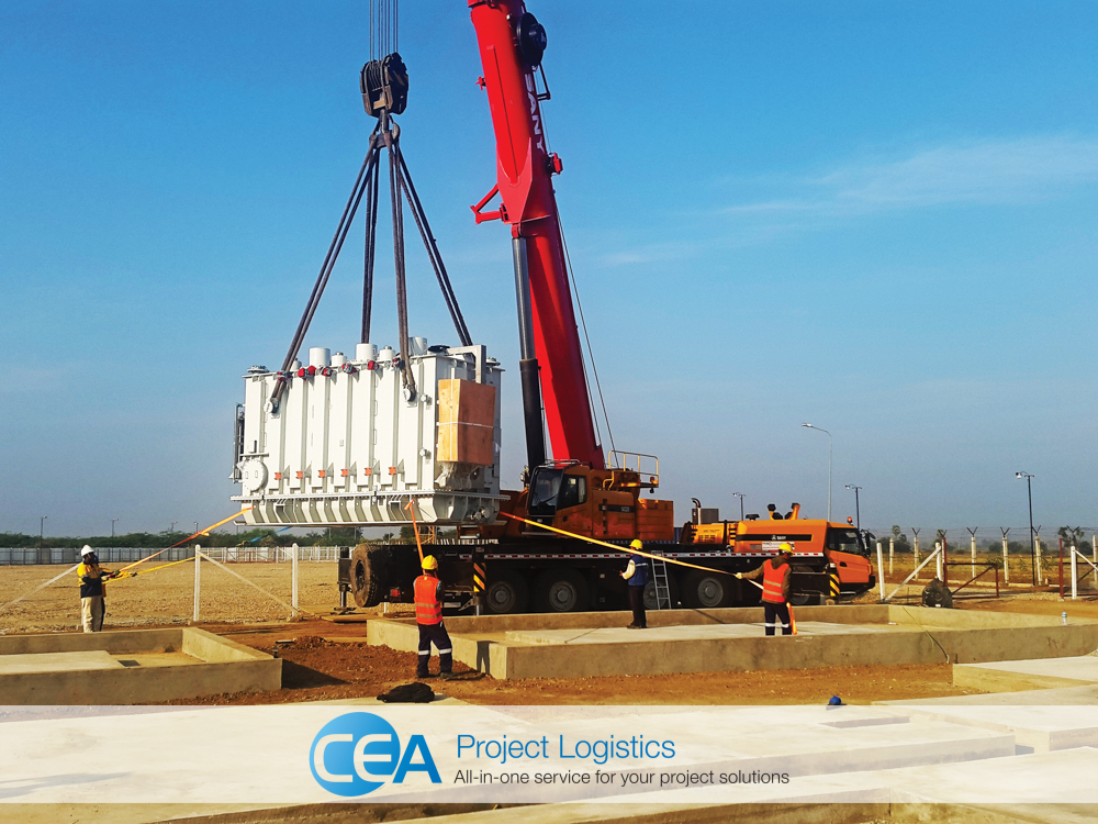 Red crane lifting a power generator in Myanmar