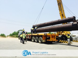 Loading monopole towers on to a trailer and truck