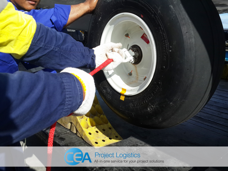 Helicopter wheels being secured on trailer