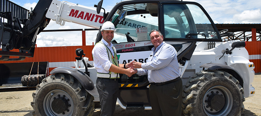 Kevin Fisher MD of CEA handing over keys to the Manitou Telehandler