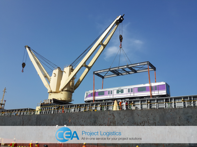 Train carriage being lifted from ship