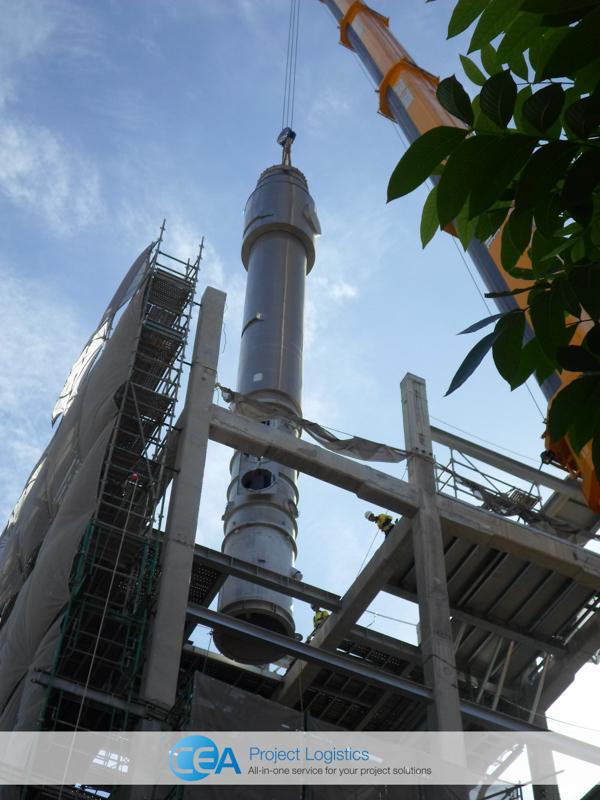 Crane lifting evaporator into place