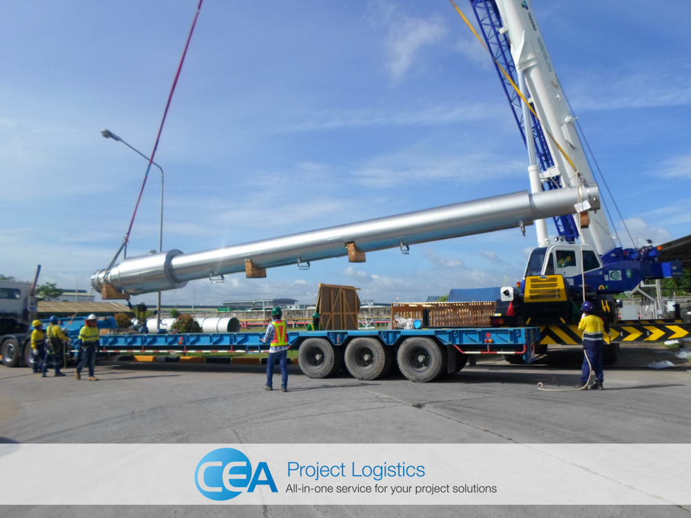 Crane lifting cargo from trailer