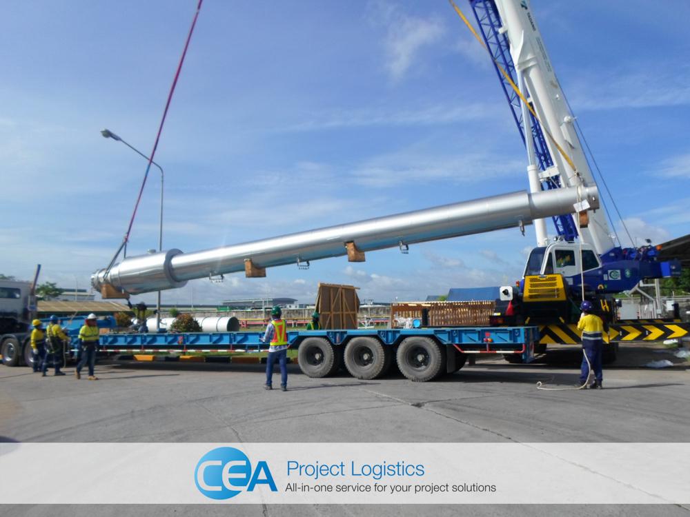 Crane lifting cargo from trailer