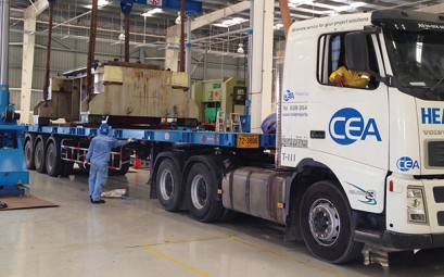 CEA Prime mover with trailer unloading metal press parts inside factory
