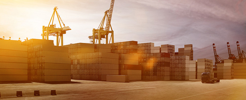Container port at sunset - freight forwarding
