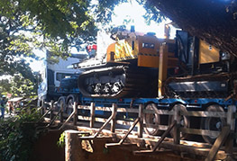 CEA Myanmar trucks crossing wooden bridge drill rig transportation
