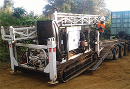 Drill rig being unloaded from CEA Myanmar Truck and trailer