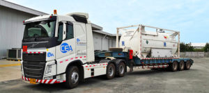 A white CEA Project Logistics Prime mover transporting industrial gas and liquids