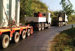 A cea project logistics convoy heading into Laos - cross border transport