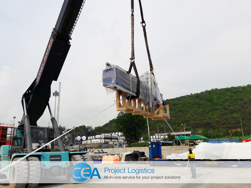 SEPRO Robot arm being lowered into open top container - CEA Project Logistics Demobilisation