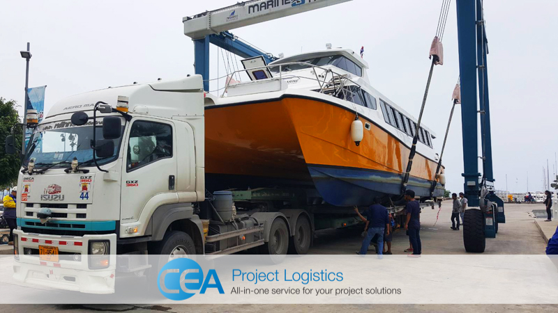 ferry lifted from water with straddle carrier - CEA Logistics Transport and export project