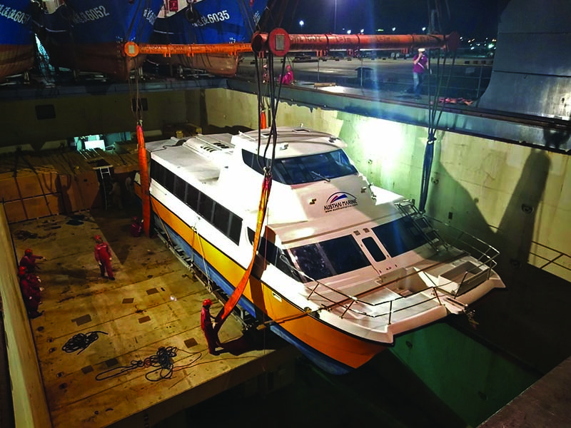 Catamaran being loaded into the ships hold -Catamaran Transport and export by cea project logistics