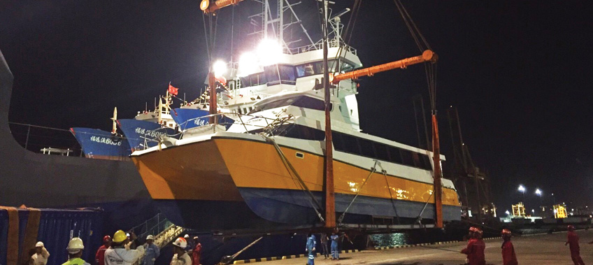 CEA Project Logistics Catamaran Transport & Export, boat being lifted from port onto ship