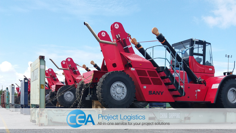 Eight reach stackers on their flat racks before transportation - CEA Project Logistics